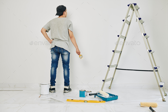 College student painting walls - Stock Photo - Images
