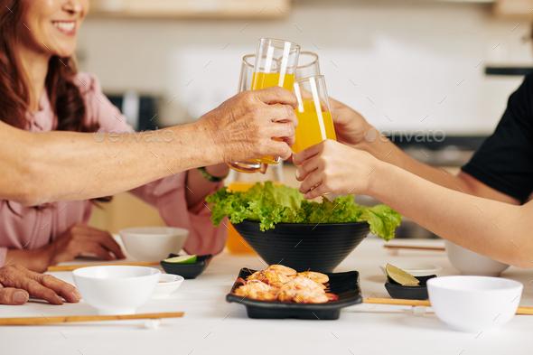 Family drinking juice - Stock Photo - Images