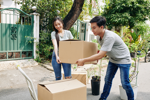 Young couple moving out - Stock Photo - Images