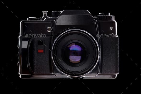 Vintage old retro 35mm film SLR camera over black - Stock Photo - Images