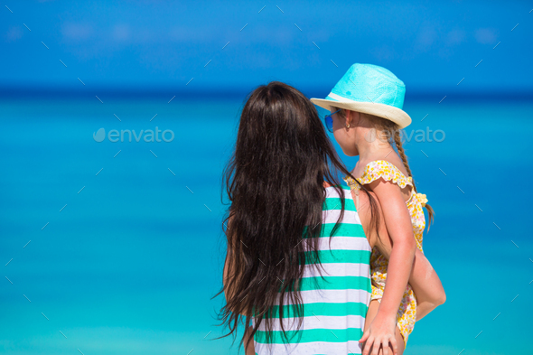 Little girl and young mom during beach vacation - Stock Photo - Images