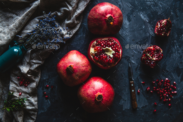 Beautiful composition of pomegranates on a dark background with a towel, healthy food, fruit - Stock Photo - Images