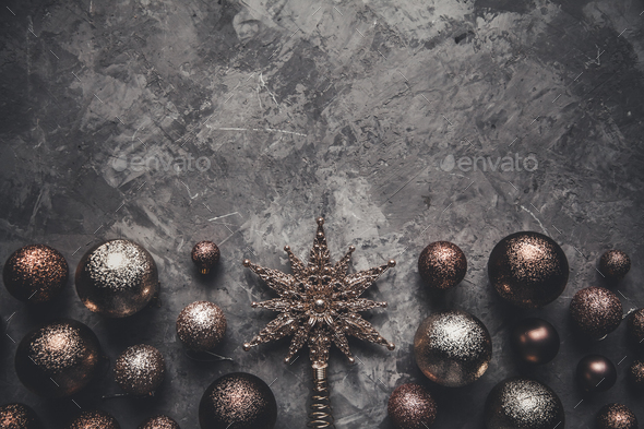 Christmas toys with a star on a gray background. New Year, decorations, cards - Stock Photo - Images