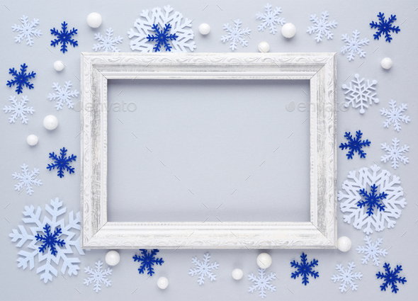 Christmas background. Photo frame and snowflakes on white background. Flat lay, top view, copy space - Stock Photo - Images