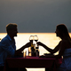 People, vacation, love and romance concept. Young couple enjoying a romantic dinner on beach - PhotoDune Item for Sale