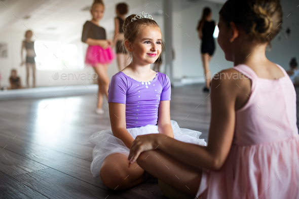 Group of fit happy children exercising ballet in studio together - Stock Photo - Images