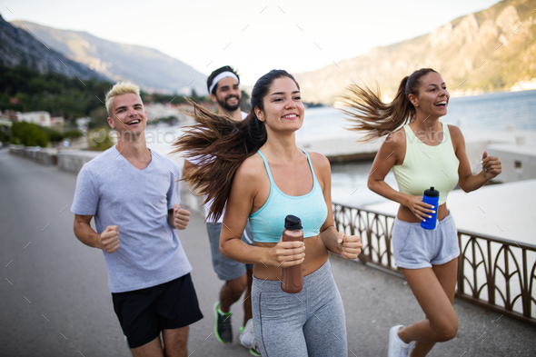 Friends fitness training together outdoors living active healthy - Stock Photo - Images
