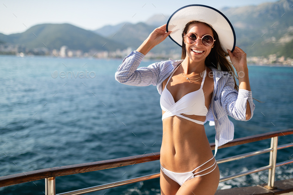 Young sexy woman in bikini enjoying summer vacation on beach - Stock Photo - Images