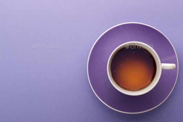 Cup of tea on lilac background - Stock Photo - Images