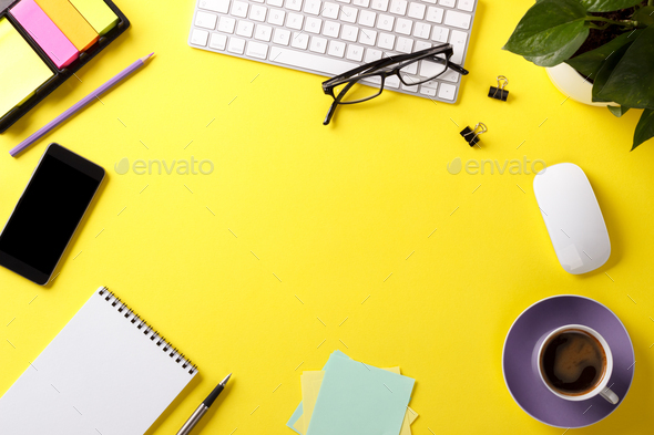 Yellow office desk with supplies - Stock Photo - Images