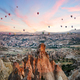 Balloons over rocks of Cappadocia in early morning - PhotoDune Item for Sale