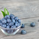 Blueberries in glass bowl on a wooden table - PhotoDune Item for Sale