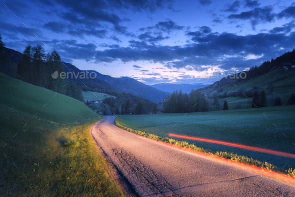 Blurred car headlights on rural road at night in summer - Stock Photo - Images