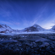 Blue sky with stars rocky beach and snow covered mountains - PhotoDune Item for Sale