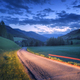 Blurred car headlights on rural road at night in summer - PhotoDune Item for Sale