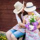 Gardening, planting - mother with daughter planting flowers into the flowerpot - PhotoDune Item for Sale
