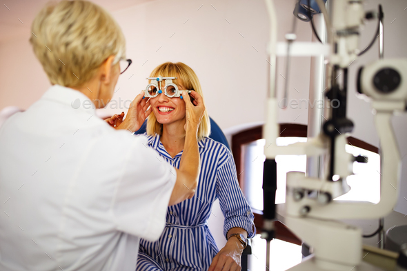 Ophthalmology eyesight diagnostic concept. Modern eye test machine equipment in clinic - Stock Photo - Images