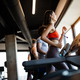 Group of young people running on treadmills in modern sport gym - PhotoDune Item for Sale