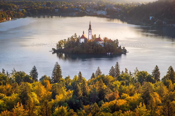 Colorful landscape view of and island and Lake Bled with colorful autumn foliage, Slovenia - Stock Photo - Images