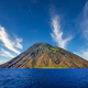Volcanic island Stromboli in Lipari viewed from the ocean with nice clouds, Sicily - PhotoDune Item for Sale