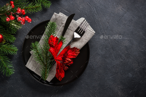 Christmas table setting on black top view - Stock Photo - Images
