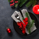 Christmas table setting on black top view - PhotoDune Item for Sale