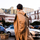 Back view of young stylish man in trench coat walking through street - PhotoDune Item for Sale