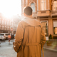 Back view of young confident man in trench coat walking through city street - PhotoDune Item for Sale