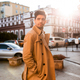 Young attractive stylish man in trench coat intently looking away on street - PhotoDune Item for Sale