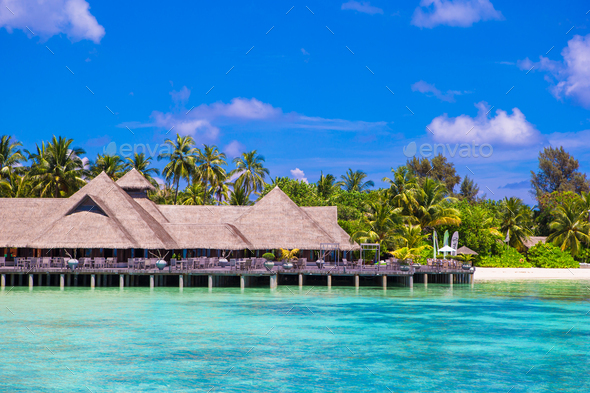 Summer empty outdoor cafe on shore at exotic island in indian ocean - Stock Photo - Images