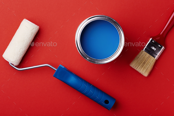 Can of Blue Paint with Brush and Paint Roller. - Stock Photo - Images
