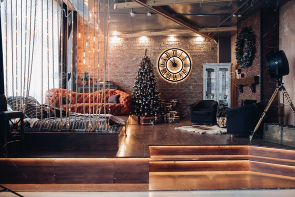 Modern studio with Christmas tree. Loft design interior - Stock Photo - Images