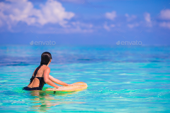 Beautiful fitness surfer woman surfing during summer vacation - Stock Photo - Images