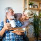 Happy smiling senior couple embracing together at home - PhotoDune Item for Sale