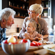 Happy grandparents with grandchildren making breakfast in kitchen - PhotoDune Item for Sale