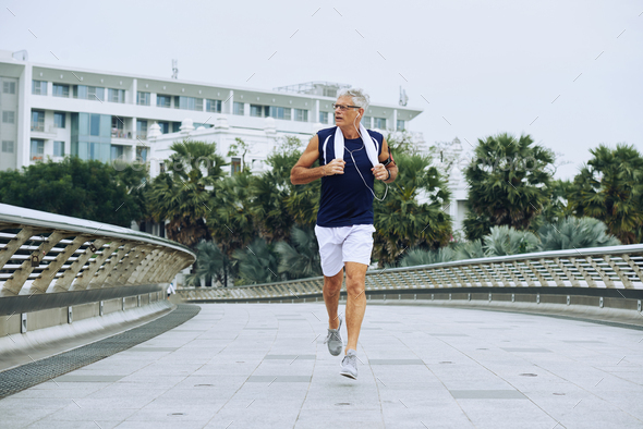 Jogging aged man - Stock Photo - Images