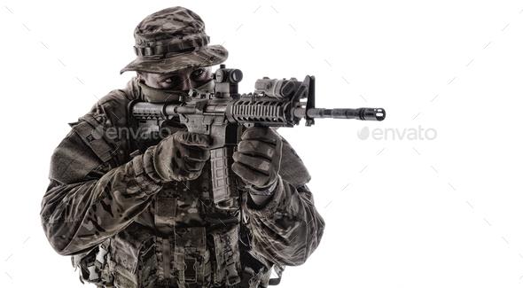 Army infantryman aiming service rifle studio shoot - Stock Photo - Images