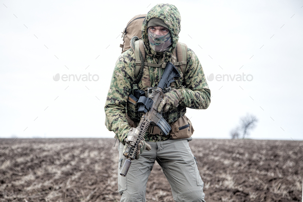 Portrait of modern army infantryman on march - Stock Photo - Images