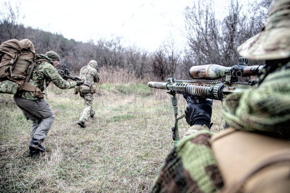 Commando army soldiers fighters squad rushing in woodland - Stock Photo - Images
