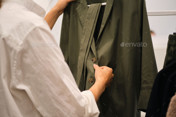 Close up young stylish woman working in showroom on new collection - Stock Photo - Images