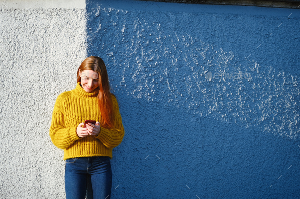 Young Redhead Woman Sending Text Message With Phone - Stock Photo - Images