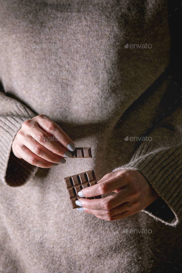 Dark chocolate in hands - Stock Photo - Images