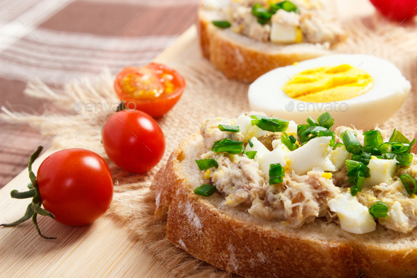 Sandwiches or baguette with mackerel or tuna fish paste, healthy nutrition - Stock Photo - Images