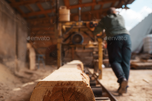 Joiner works on woodworking machine, lumbering - Stock Photo - Images