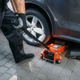 Auto mechanic jacks the car in tire service - PhotoDune Item for Sale