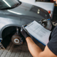 Mechanic holds inspection report, tire service - PhotoDune Item for Sale