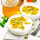 Dessert of yogurt and persimmon two bowls on wooden board - PhotoDune Item for Sale