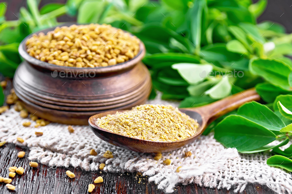 Fenugreek in spoon and bowl with green leaves on napkin - Stock Photo - Images