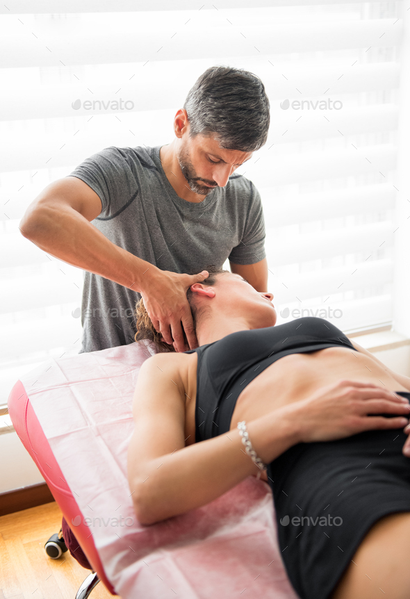 Osteopath performing cervical trust therapy - Stock Photo - Images
