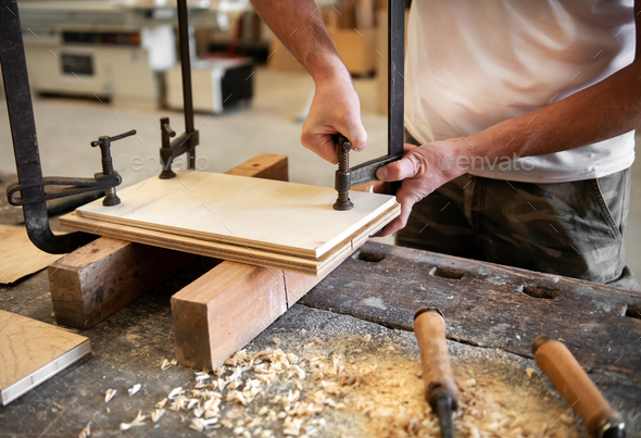 Carpenter or woodworker using a vice - Stock Photo - Images